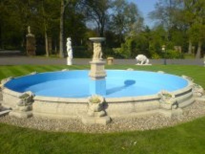 Fountain basin fibreglassing in Theydon Bois, Essex.