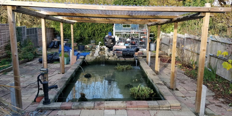 Arnos Grove, London pond cleaning
